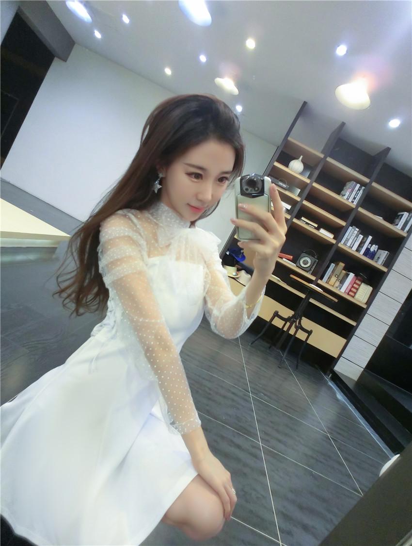 ชุดเดรสแฟชั่นเกาหลีสีขาวไฮโซ