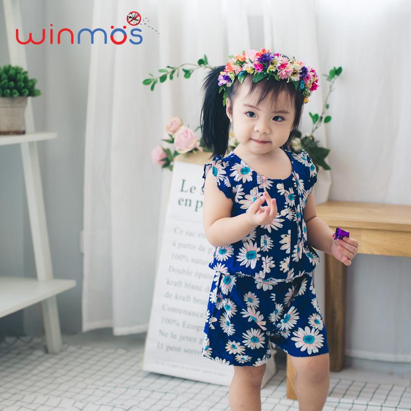 W104 : จั๊มสูทแขนกุดผ้าคอตต้อนสีน้ำเงินพิมพ์ลายดอกไม้ ติดยางยืดช่วงเอว
